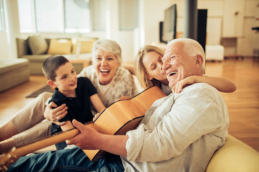 Grandparents playing guitar with grand kids
