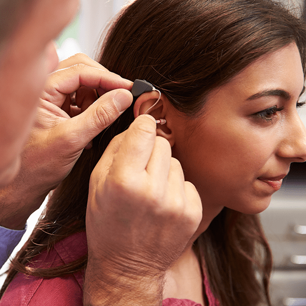 Fitting hearing aid with young woman