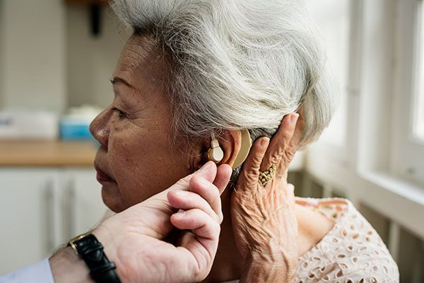 Hearing aid on woman