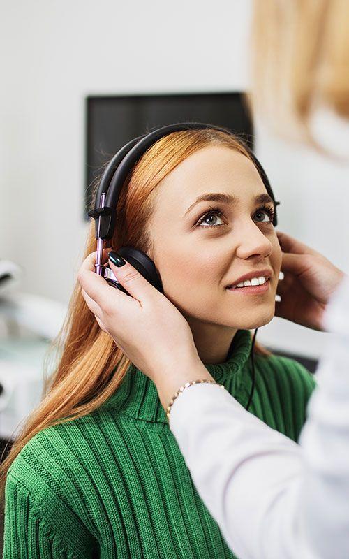 Woman getting hearing test