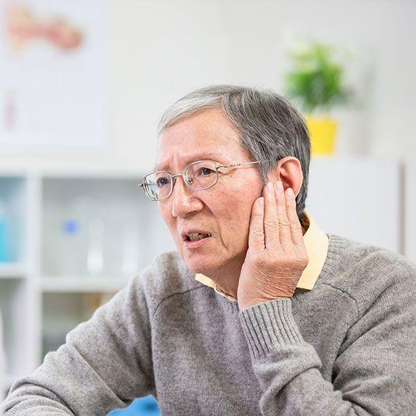 Man describing hearing issue